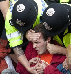 One of the protectors receiving a nasty piece of police tactic.