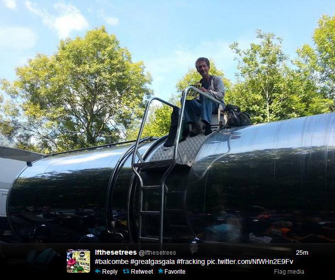 Rob an Anti fracking activist climbs a loaded lorry exiting the Balcombe Cuadrilla site and d-locks himself to the vehicle