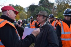 Friends defending friends at the eviction of Balcombe Community Protection Camp.