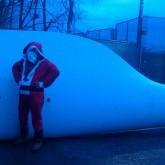 Santa bearing a big present.