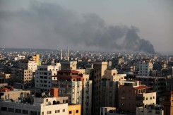 Smoke rises after an Israeli shelling at the Shijaiyah neighborhood in Gaza City,