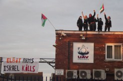 Activists occupying roof of UAV Engines, wholly owned subsidiary of Elbit  copy