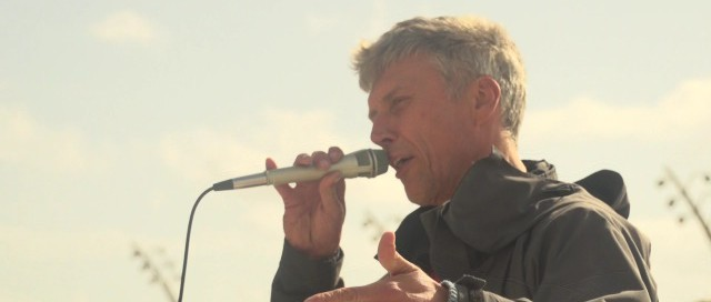 Bez from Happy Mondays fame, current member of the Reality Party speaks at the end of the march.