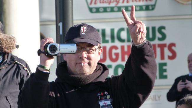 EDL member taking video footage of anti-fascists.