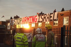 Police look on as protesters occupy roof of Elbit owned factory in Birmingham copy