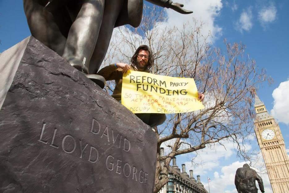 Occupying David Lloyd George plinth.  Photo: Dan Cole